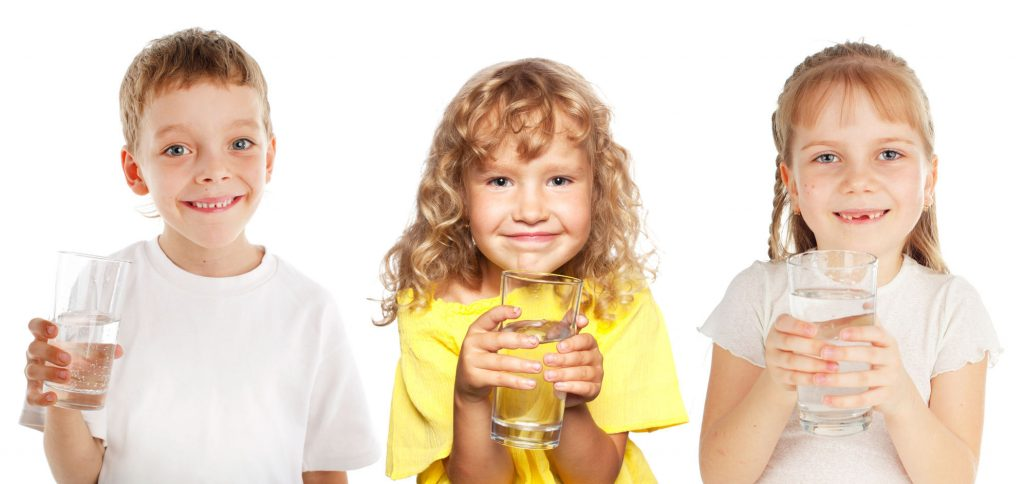 Children Drinking Glasses of Distilled Water